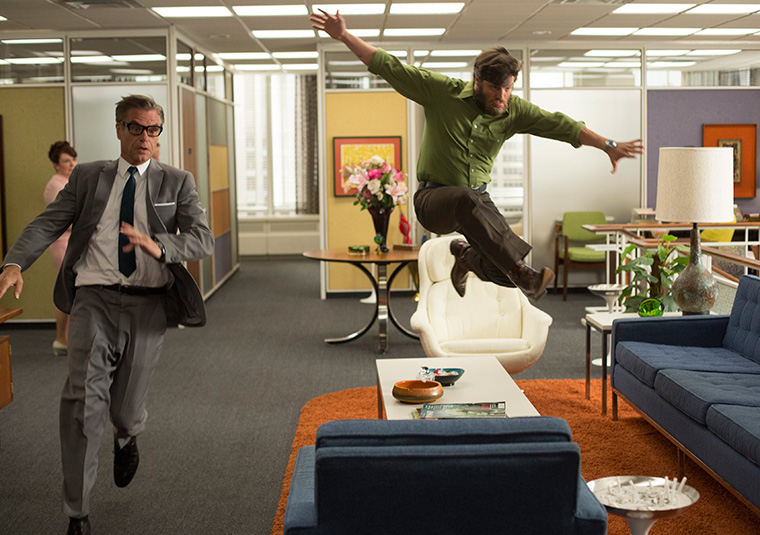 Stan and Jim jumping at the office
