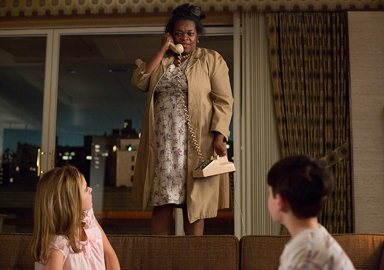Grandma Ida stands over Sally and Bobby in the Draper apartment